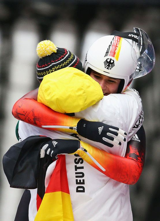 . Natalie Geisenberger of Germany is congratulated for winning gold medal in the Women\'s Luge Singles on Day 4 of the Sochi 2014 Winter Olympics at Sliding Center Sanki on February 11, 2014 in Sochi, Russia.  (Photo by Alex Livesey/Getty Images)