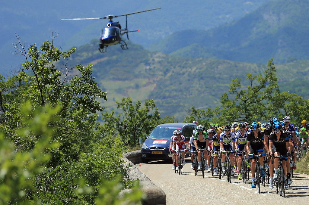 . The peloton is chased by a television helicopter during stage sixteen of the 2013 Tour de France, a 168KM road stage from Vaison-la-Romaine to Gap, on July 16, 2013 in Gap, France.  (Photo by Doug Pensinger/Getty Images)