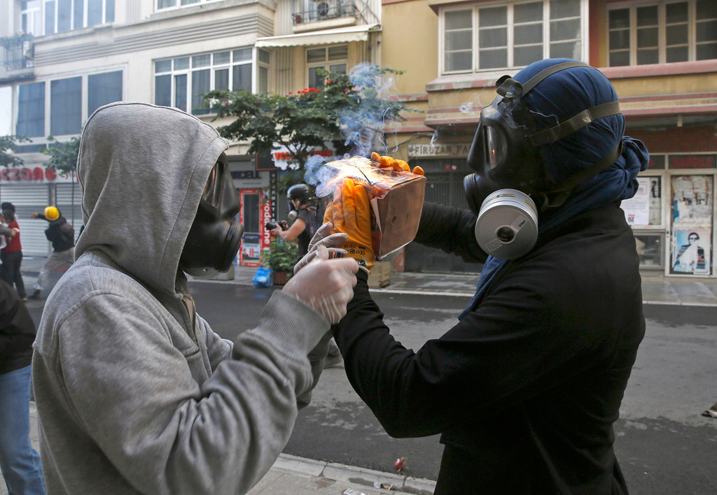 . Two protesters prepare a home made device for launching fireworks during a protest at Taksim Square in Istanbul June 11, 2013.  REUTERS/Yannis Behrakis