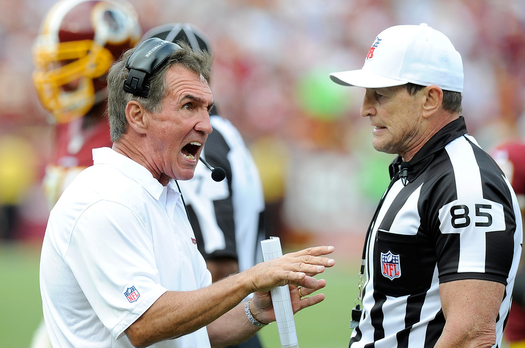 . LANDOVER, MD - SEPTEMBER 22:  Head coach Mike Shanahan of the Washington Redskins argues a call with referee Ed Hochuli #85 in the fourth quarter against the Detroit Lions at FedExField on September 22, 2013 in Landover, Maryland.  (Photo by Greg Fiume/Getty Images)