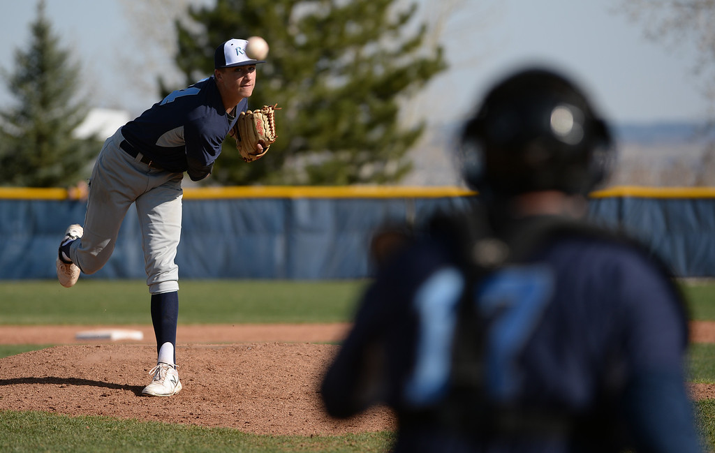 . LITTLETON, CO - APRIL 16,  2014: Ralston Valley Mustangs pitcher Jordan Holloway warms up during the second inning of their game against the Columbine Rebels at Columbine High School in Littleton, Co on April 17, 2014. (Photo By Helen H. Richardson/ The Denver Post)