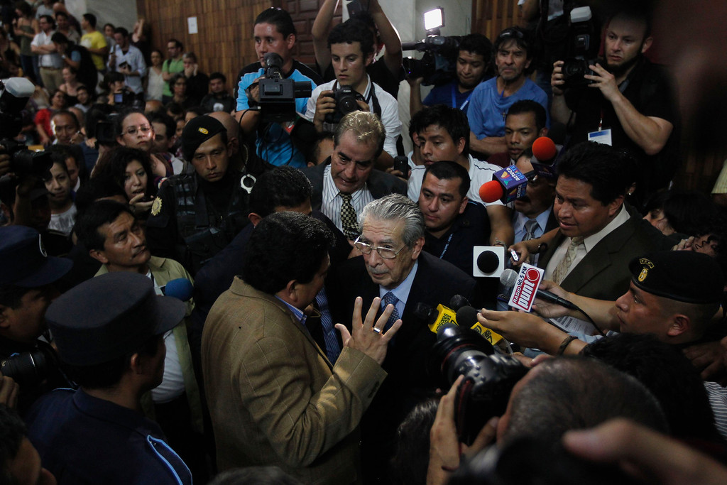. Former Guatemalan dictator Efrain Rios Montt is surrounded by the media after he was sentenced for genocide charges in the Supreme Court of Guatemala City May 10, 2013. Montt was found guilty on Friday of genocide and crimes against humanity during the bloodiest phase of the country\'s 36-year civil war and was sentenced to 80 years in prison. REUTERS/Jorge Dan Lopez