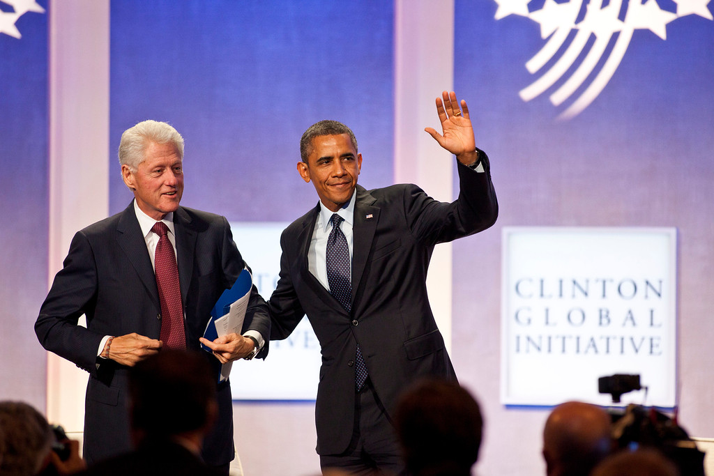 . NEW YORK - SEPTEMBER 24: Former U.S. President Bill Clinton (L) and to U.S. President Barack Obama wave on stage during the annual Clinton Global Initiative (CGI) meeting on September 24, 2013 in New York City. Timed to coincide with the United Nations General Assembly, CGI brings together heads of state, CEOs, philanthropists and others to help find solutions to the world\'s major problems.  (Photo by Ramin Talaie/Getty Images)