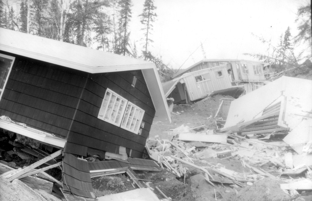 . Alaska Earthquake March 27, 1964. Homes devastated by the Turnagain Heights landslide in Anchorage, deep within the slide area. About 75 homes were destroyed. Photo by W.R. Hansen, U.S. Geological Survey