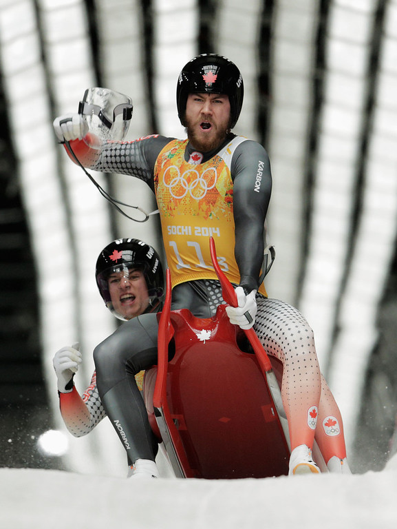 . Tristan Walker and Justin Snith of Canada react after a run during the Luge Relay on Day 6 of the Sochi 2014 Winter Olympics at Sliding Center Sanki on February 13, 2014 in Sochi, Russia.  (Photo by Adam Pretty/Getty Images)
