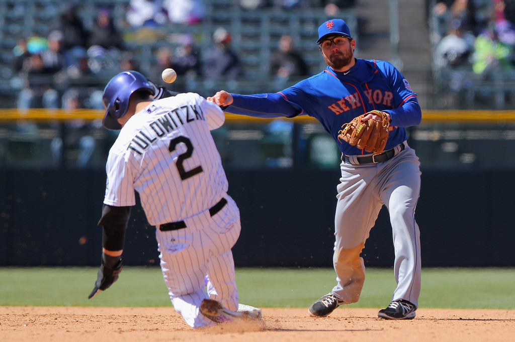 . Second baseman Daniel Murphy #28 of the New York Mets turns a double play on Troy Tulowitzki #2 of the Colorado Rockies in the sixth inning at Coors Field on April 18, 2013 in Denver, Colorado.  (Photo by Doug Pensinger/Getty Images)