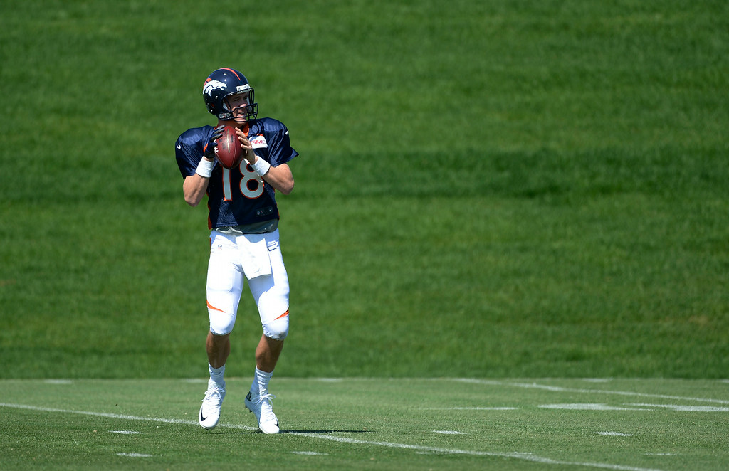 . Denver Broncos quarterback Peyton Manning (18) looks to throw a pass during practice at the Denver Broncos 2014 training camp August 11, 2014 at Dove Valley. (Photo by John Leyba/The Denver Post)
