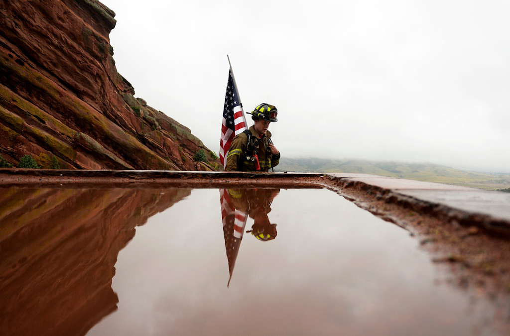 . Firefighter Vincent Van Binsbergen, from Elk Creek Fire Department in Conifer, joined other firefighters and community members at Red Rocks Amphitheater to honor the people and events of 9/11, September 11, 2013. The 911 Stair Climb at Red Rocks is designed to equate to 110 stories, the height of the World Trade Center\'s Twin Towers. (Photo By RJ Sangosti/The Denver Post)