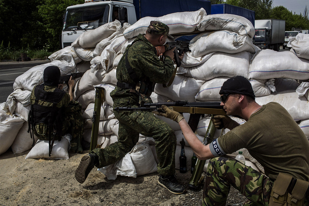 . Gunmen from the Vostok Battalion, a pro-Russia militia, stand guard at a checkpoint in Pisky, some 15 km from Donetsk, eastern Ukraine, on the road between Donetsk and Krasnoarmiisk, on May 23, 2014. AFP PHOTO / FABIO BUCCIARELLI/AFP/Getty Images