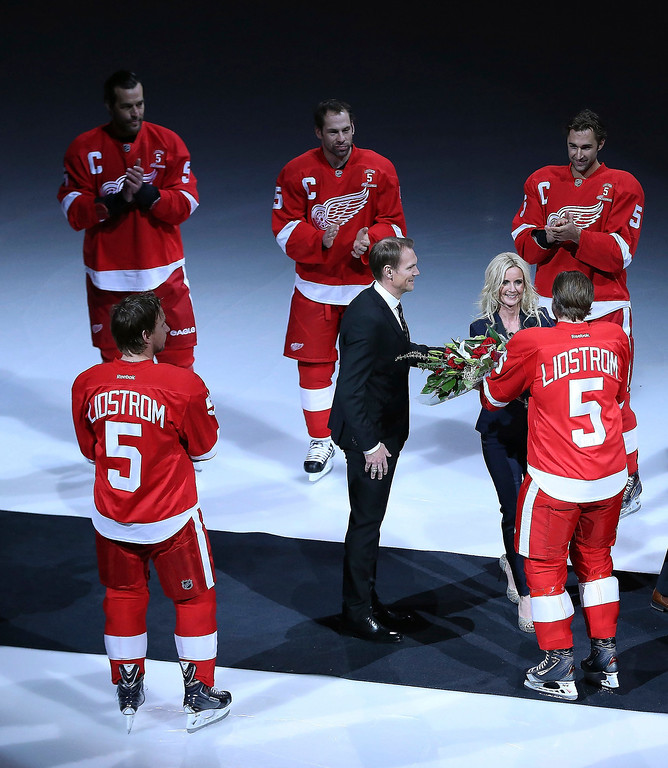 . Former Detroit Red Wings Nick Lidstrom and his wife Annika and family enter the ice arena prior to the Nick Lidstrom jersey retirement ceremony at Joe Louis Arena on March 6, 2014 in Detroit, Michigan.  (Photo by Leon Halip/Getty Images)