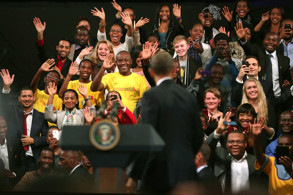 ". JOHANNESBURG, SOUTH AFRICA - JUNE 29:  Young people cheer and wave as U.S. President Barack Obama arrives for a ""town hall\"" meeting with the young African leaders at the University of Johannesburg in Soweto June 29, 2013 in Johannesburg, South Africa. South Africa is the second leg of Obama\'s three-country tour of the African continent, which includes Senegal and Tanzania.  (Photo by Chip Somodevilla/Getty Images)"