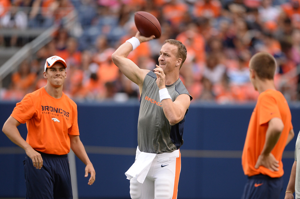 . DENVER, CO. - August 03: Peyton Manning of Denver Broncos (18) is warming up for the scrimmage at Sports Authority Field at Mile High. Denver, Colorado. August 03, 2013. (Photo By Hyoung Chang/The Denver Post)