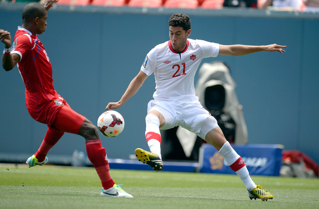. Jonathan Osorio #21 of Canada tries to gain control of the ball as Jean Carlos Cedeno #13 of Panama moves in on defense during the CONCACAF Gold Cup soccer game July 14, 2013 at Sports Authority Field at Mile High. (Photo By John Leyba/The Denver Post)