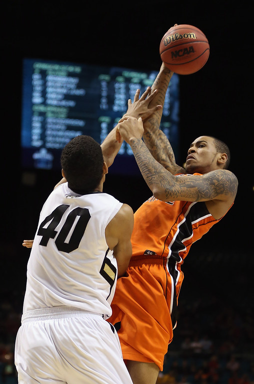 . LAS VEGAS, NV - MARCH 13:  Eric Moreland #15 of the Oregon State Beavers shoots while defended by Josh Scott #40 of the Colorado Buffaloes in the second half during the first round of the Pac 12 Tournament at the MGM Grand Garden Arena on March 13, 2013 in Las Vegas, Nevada. Colorado defeated Oregon State 74-68.  (Photo by Jeff Gross/Getty Images)