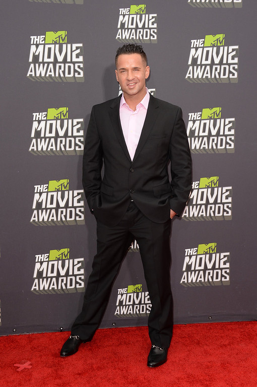 ". TV personality Mike ""The Situation\"" Sorrentino arrives at the 2013 MTV Movie Awards at Sony Pictures Studios on April 14, 2013 in Culver City, California.  (Photo by Jason Merritt/Getty Images)"