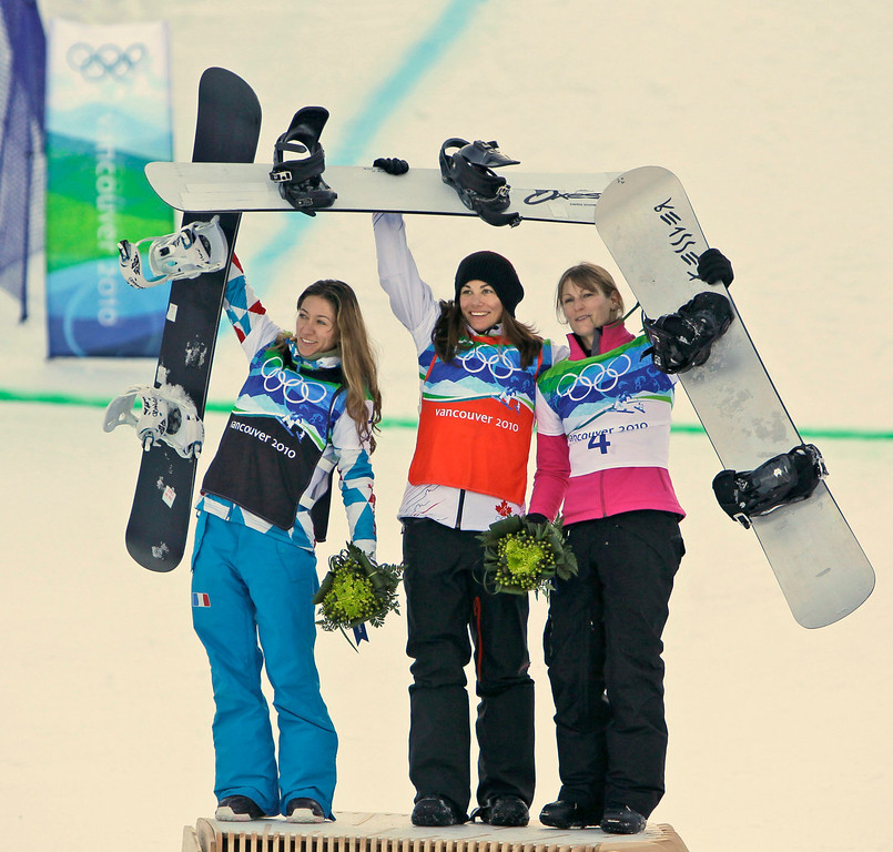 . Olympic Champion Maelle Ricker of Canada, center celebrates with runner up, Deborah Anthonioz of France, left and third placed Faye Gulini of the USA, right after the ladies snowboardcross at the Vancouver 2010 Olympics in Vancouver, British Columbia, Tuesday, Feb. 16, 2010. (AP Photo/Gerry Broome)
