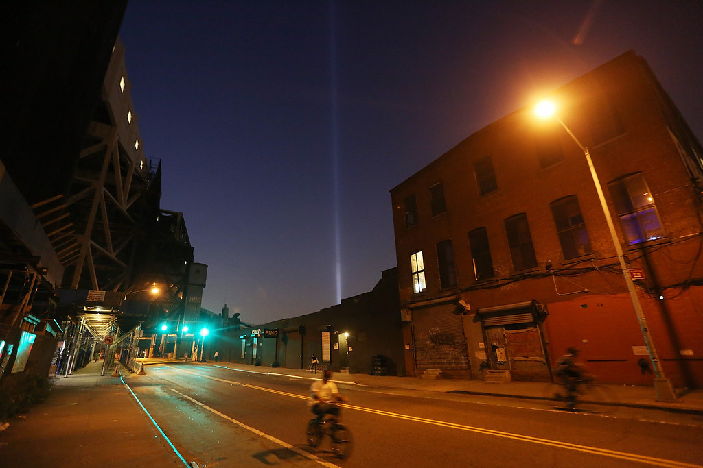 . NEW YORK, NY - SEPTEMBER 10:  New York City\'s Tribute In Light shines above a Brooklyn street on the eve of the twelfth anniversary of the terrorist attacks at the World Trade Center on September 10, 2013 in New York City. New York City and the nation will commemorate the eleventh anniversary of the September 11, 2001 attacks, which resulted in the deaths of nearly 3,000 people after two hijacked planes crashed into the World Trade Center towers, one into the Pentagon in Arlington, Virginia and one into a field outside OF Shanksville, Pennsylvania.  (Photo by Mario Tama/Getty Images)