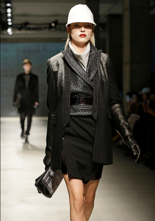 . A model walks the runway at the presentation of the Kenneth Cole Fall 2013 fashion collection during Fashion Week in New York, Thursday, Feb. 7, 2013.  (AP Photo/Kathy Willens)