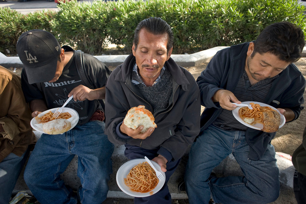 . Jose Ruiz (C), 47, eats a meal provided by the La Roca del Alfarero, a Christian-run homeless shelter, in Tijuana, Mexico, 07 May 2013. Ruiz had been living undocumented in Los Angeles for 30 years before he was deported to Mexico in February. He has been living homeless since. Heightened US border security and record numbers of deportations from the US have created a growing population of people who live homeless in Mexican cities that border with the United States. Many had lived for years undocumented in the US and have little or no family and other support in Mexico, and are subject to fall into depression, substance abuse and crime. Tijuana, Mexico, borders on the US city of San Diego, California.  EPA/DAVID MAUNG