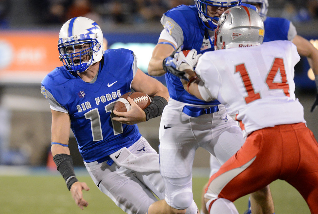 . Air Force QB Connor Dietz (11) scrambles against New Mexico defense in the 2nd half of the game at Falcon Stadium. Colorado Springs. Saturday, October 20, 2012. Hyoung Chang, The Denver Post