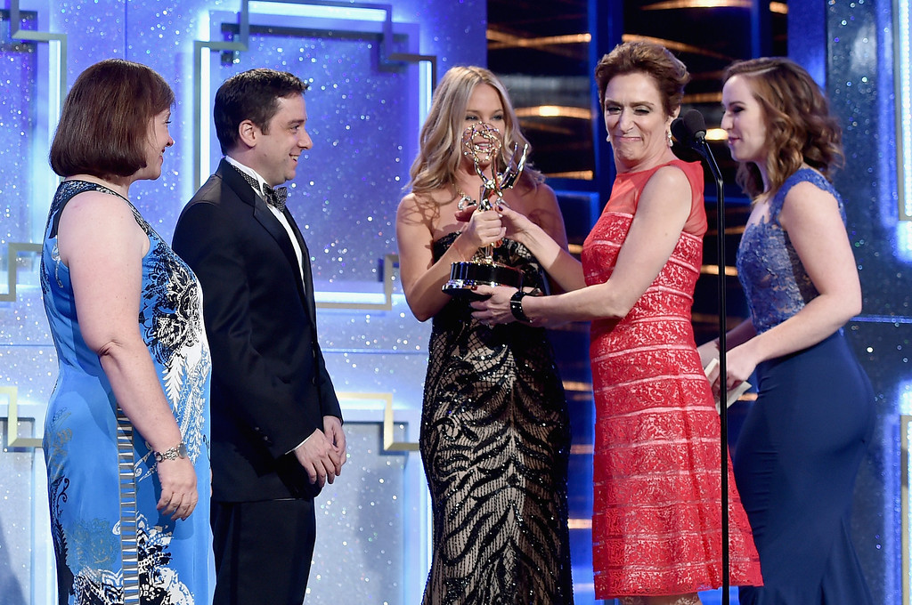 . Writers Jean Passanante (L) and Shelly Altman (2nd R) accept Outstanding Drama Series Writing Team for \'The Young and the Restless\' from actresses Sharon Case (C) and Camryn Grimes (R) onstage during The 41st Annual Daytime Emmy Awards at The Beverly Hilton Hotel on June 22, 2014 in Beverly Hills, California.  (Photo by Alberto E. Rodriguez/Getty Images for NATAS)