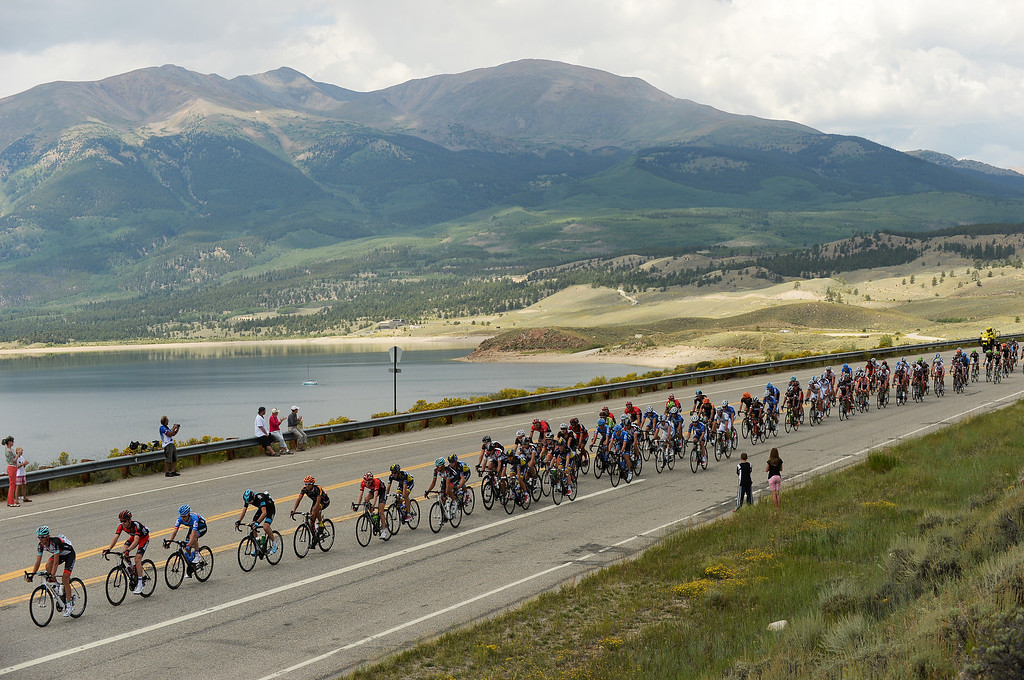. The peloton rides past Twin Lakes during the 126.4 -mile second stage of the 2013 USA Pro Challenge race from Aspen to Breckenridge on Tuesday,  August 20, 2013. (Photo By Hyoung Chang/The Denver Post)