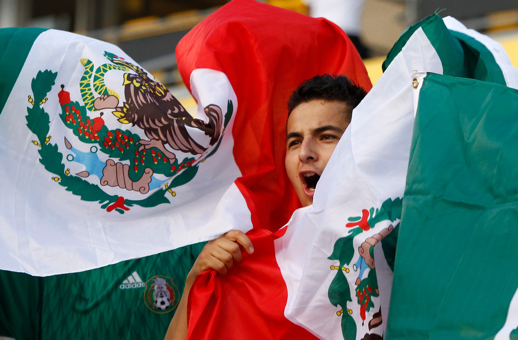 . A Mexico fan cheers before the start of the Brazil 2014 FIFA World Cup qualifier between USA and Mexico at Columbus Crew Stadium in Columbus, Ohio, September 10, 2013.  AFP PHOTO / Paul VERNONPaul VERNON/AFP/Getty Images