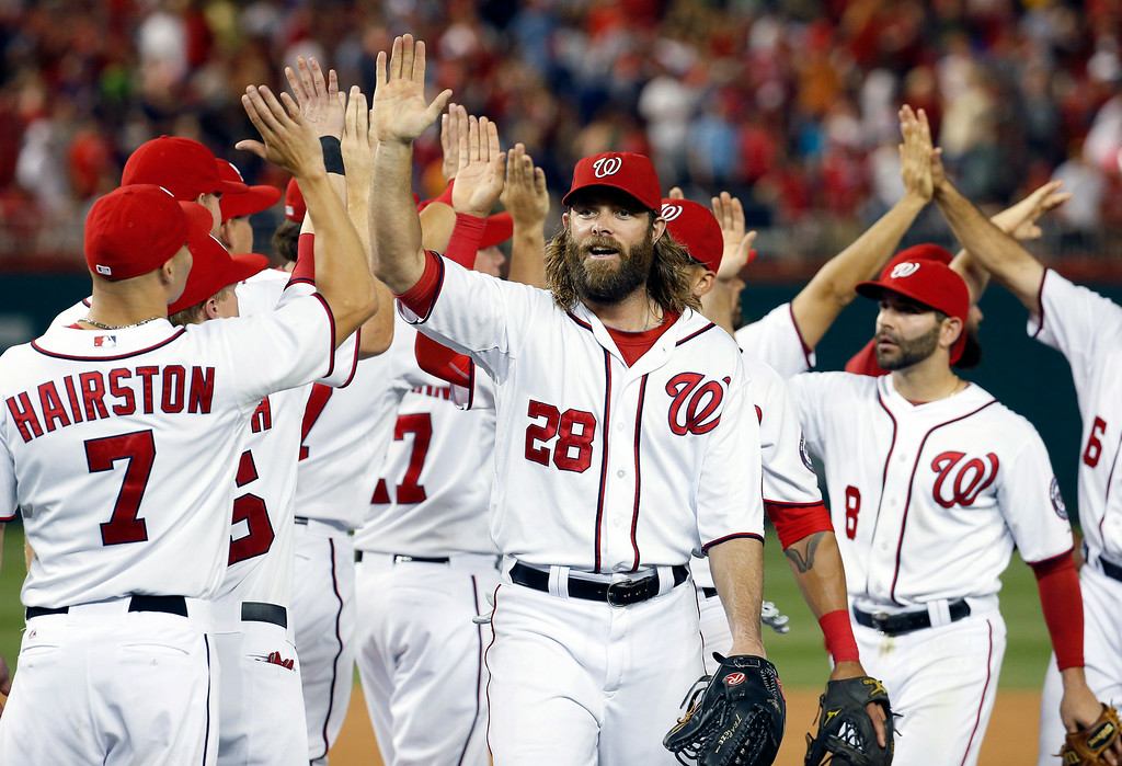 . Washington Nationals\' Jayson Werth (28) celebrates with Scott Hairston (7) and others after a baseball game against the Colorado Rockies at Nationals Park, Wednesday, July 2, 2014, in Washington. The Nationals won 4-3, and swept the three-game series with the Rockies. (AP Photo/Alex Brandon)