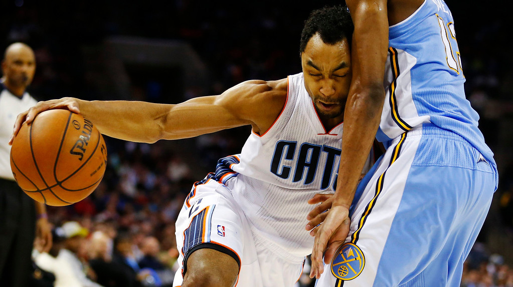 . Charlotte Bobcats shooting guard Gerald Henderson (9) tries to drive the ball past Denver Nuggets small forward Corey Brewer (R) during the second half of their NBA basketball game in Charlotte, North Carolina February 23, 2013. REUTERS/Chris Keane