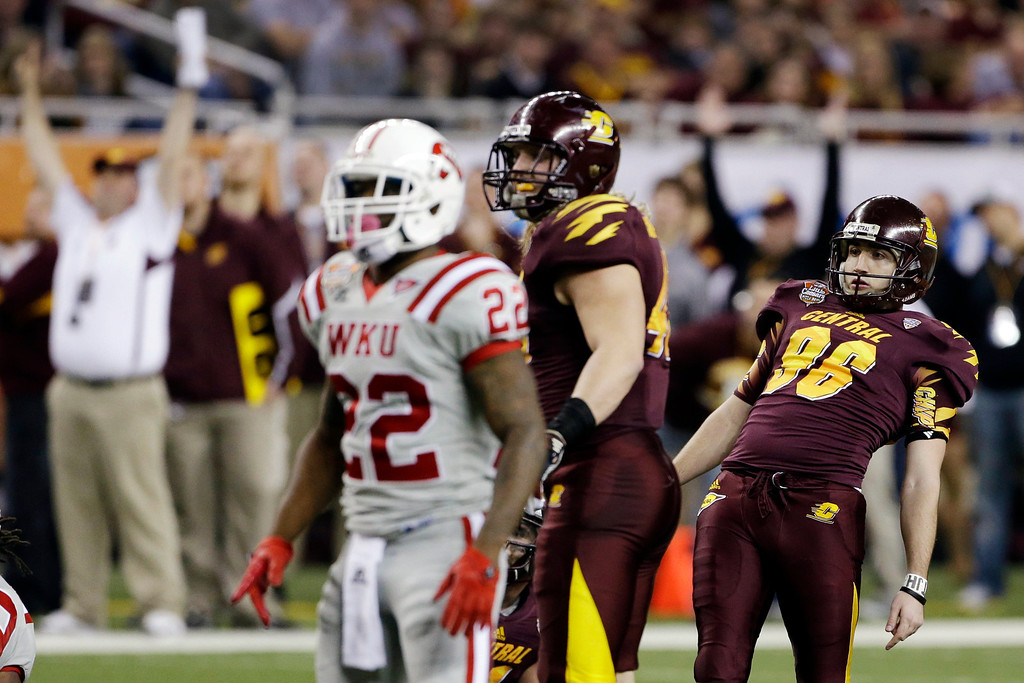 . Central Michigan kicker David Harman (96) watches as his 50-yard field goal clears the post during the second quarter of the Little Caesars Pizza Bowl NCAA college football game against Western Kentucky at Ford Field in Detroit, Wednesday, Dec. 26, 2012. Western Kentucky defensive back Tyree Robinson (22) watches the play. (AP Photo/Carlos Osorio)