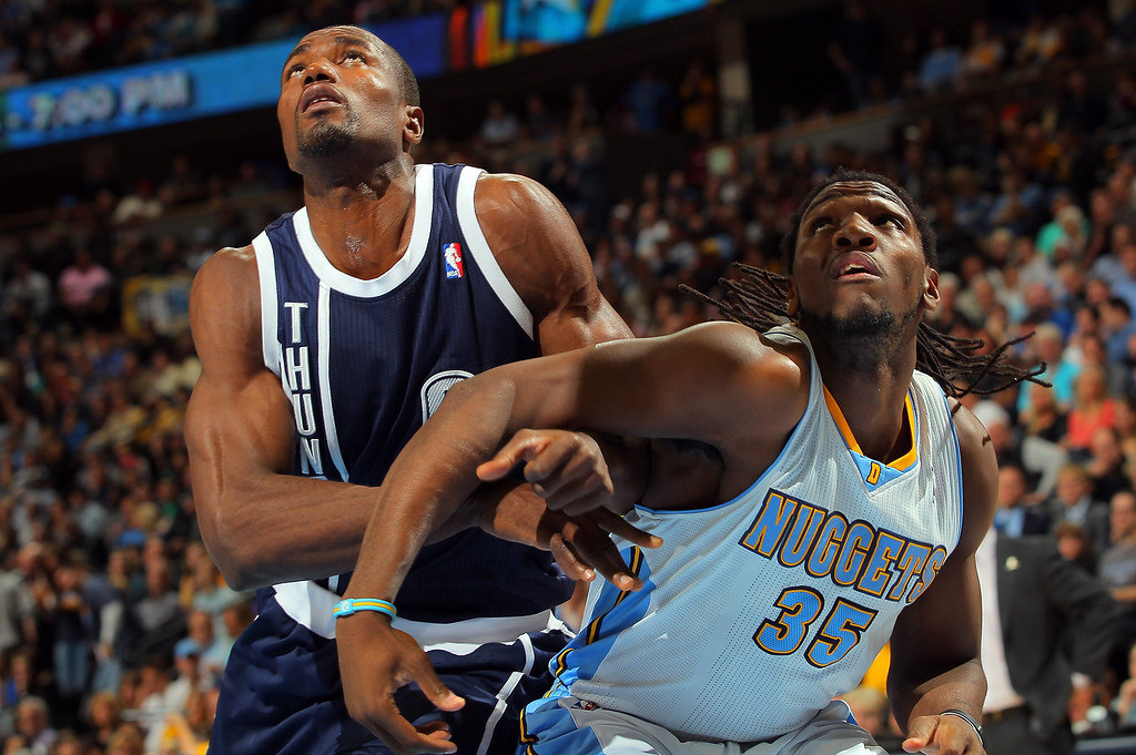 . DENVER, CO - MARCH 01:  Serge Ibaka #9 of the Oklahoma City Thunder and Kenneth Faried #35 of the Denver Nuggets battle for rebounding position at the Pepsi Center on March 1, 2013 in Denver, Colorado.  (Photo by Doug Pensinger/Getty Images)
