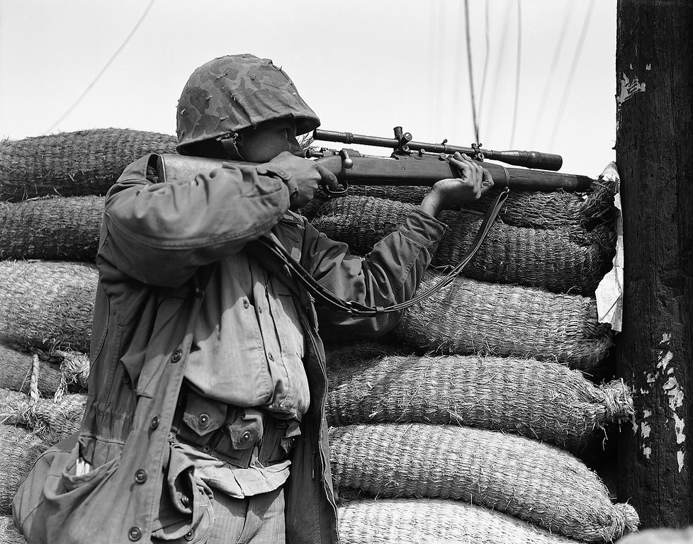 . A U.S. Marine Marksman using a telescopic sight and with his Springfield cocked and ready, waits for a troublesome North Korean sniper to pop up so he can pick him off in Seoul, capital city of South Korea on Sept. 28, 1950. (AP Photo/Max Desfor