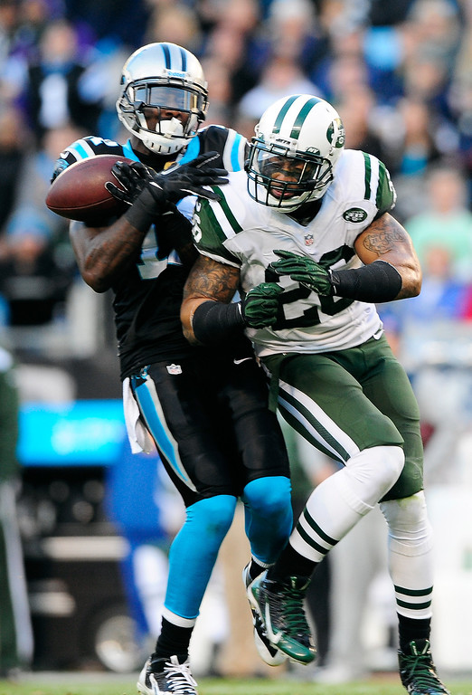 . Brandon LaFell #11 of the Carolina Panthers holds on to make the catch as he is hit by Kyle Wilson #20 of the New York Jets during play at Bank of America Stadium on December 15, 2013 in Charlotte, North Carolina.  (Photo by Grant Halverson/Getty Images)