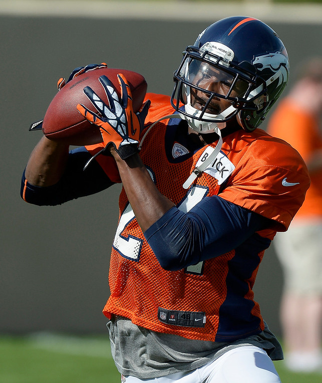 . Denver Broncos cornerback Champ Bailey (24) catches a pass in drills during training camp August 6, 2013 at Dove Valley. (Photo By John Leyba/The Denver Post)