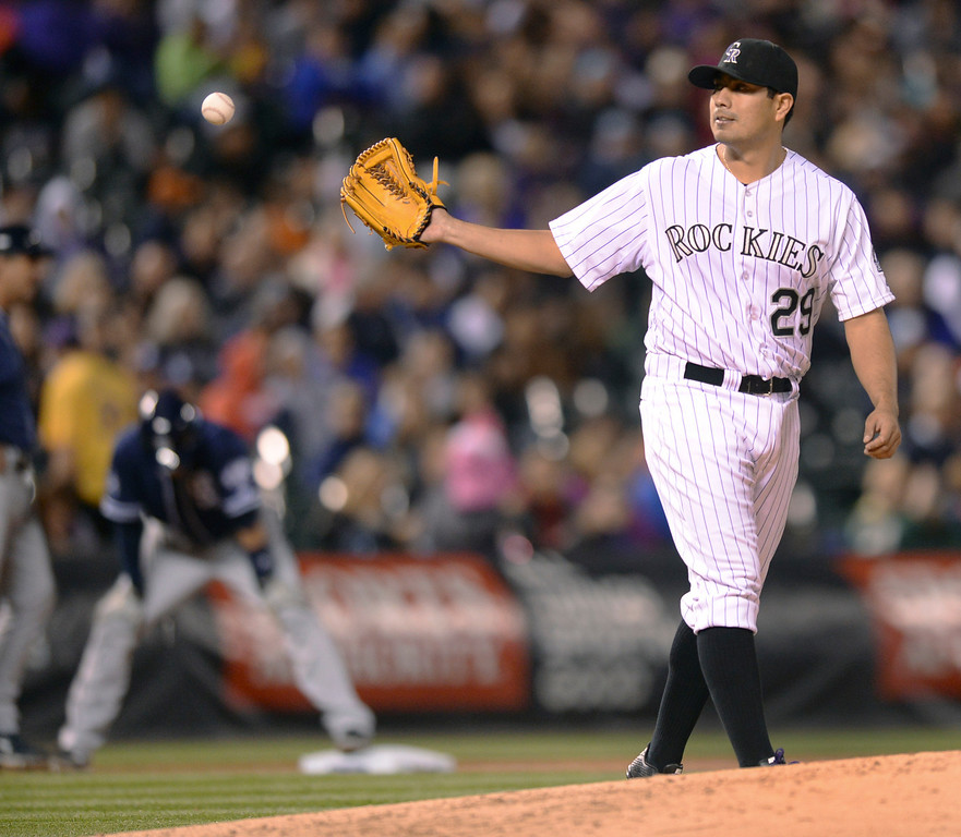 . DENVER, CO - MAY 15: Colorado starter Jorge De La Rosa allowed a triple by Chris Denorfia in the seventh inning, his only hit allowed in seven innings of work Friday night. The Colorado Rockies hosted the San Diego Padres at Coors Field  Friday night, May 16, 2014. (Photo by Karl Gehring/The Denver Post)