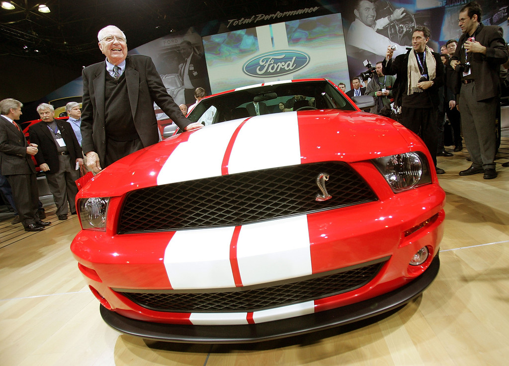 . Manufacturer and automotive legend Carroll Shelby stands next to the Ford Shelby Mustang Cobra GT500 at the 2005 New York International Auto Show March 23, 2005 in New York City.   (Photo by Mario Tama/Getty Images)