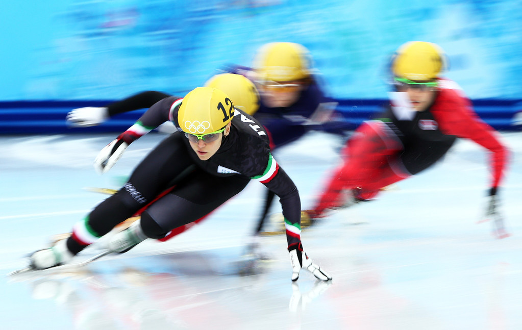 . SOCHI, RUSSIA - FEBRUARY 13:  Arianna Fontana of Italy leads the pack in the Women\'s Short Track 500m heats on day 6 of the Sochi 2014 Winter Olympics at at Iceberg Skating Palace on February 13, 2014 in Sochi, Russia.  (Photo by Clive Mason/Getty Images)