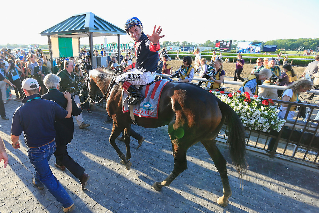 . ELMONT, NY - JUNE 07:  Tonalist #11, ridden by Joel Rosario, celebrates in the winner\'s circle after winning the 146th running of the Belmont Stakes at Belmont Park on June 7, 2014 in Elmont, New York.  (Photo by Rob Carr/Getty Images)