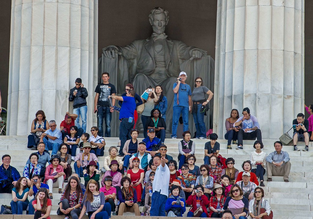 . Tourists enjoy the view from the Lincoln Memorial late September 30, 2013, as a government shutdown looms over such attractions just after midnight. This and many other non-essential government run institutions will be shut down to tourists if the US Government closes down.       AFP Photo/Paul J.  RICHARDS/AFP/Getty Images