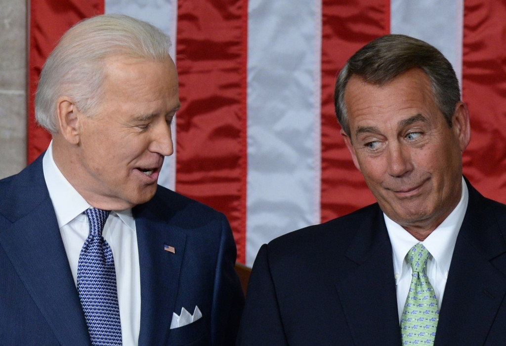 . US Vice President Joe Biden (L) confers with Speaker of the House John Boehner (R), R-OH, prior to US President Barack Obama\'s State of the Union address before a joint session of Congress on January 28, 2014 at the Capitol in Washington, DC. JEWEL SAMAD/AFP/Getty Images