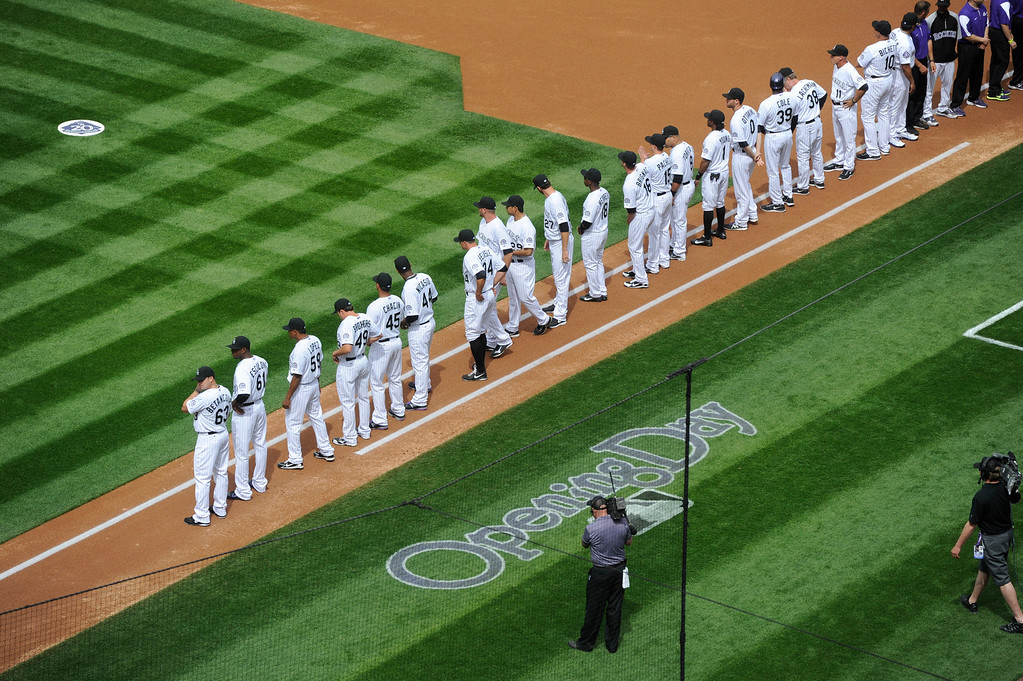 . The Colorado Rockies line up for the National Anthem before the start of the game.  (Photo by Andy Cross/The Denver Post)