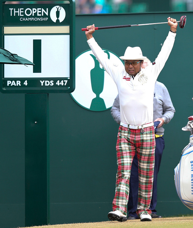 . Shingo Katayama of Japan prepares to play off the first tee during the final round of the British Open Golf Championship at Muirfield, Scotland, Sunday July 21, 2013. (AP Photo/Scott Heppell)