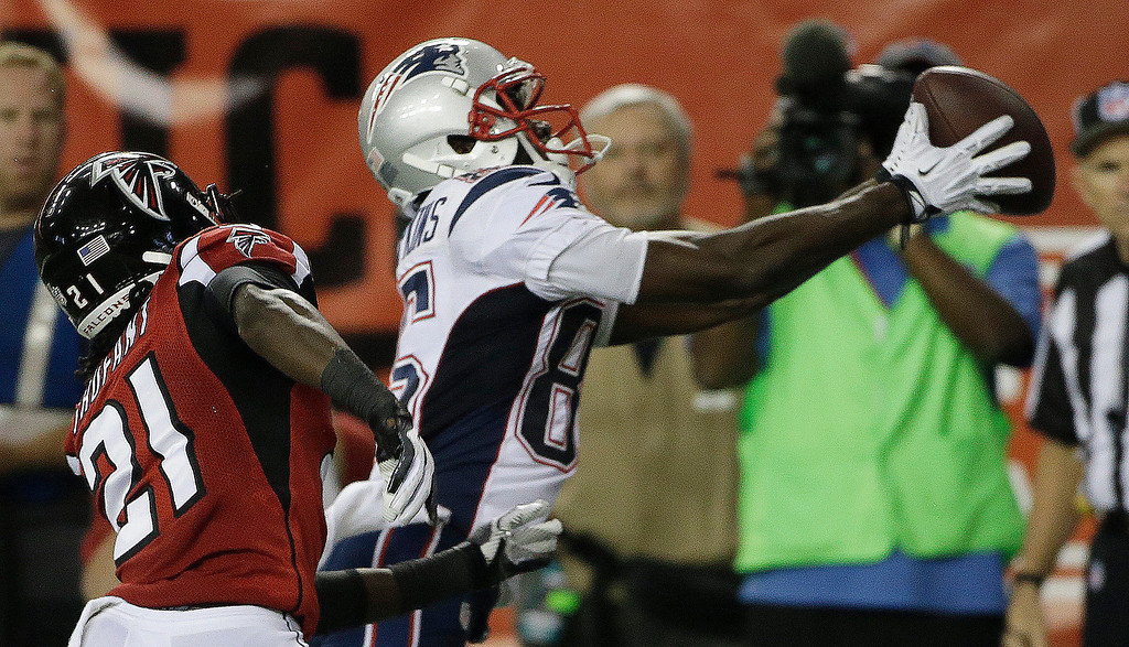. New England Patriots wide receiver Kenbrell Thompkins (85) makes a catch for a touchdown against Atlanta Falcons cornerback Desmond Trufant (21) during the second half of an NFL football game, Sunday, Sept. 29, 2013, in Atlanta. (AP Photo/John Bazemore)