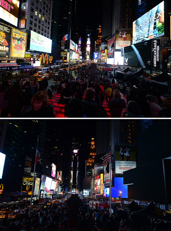 ". In this combo photo large electronic billboards stand dark (bottom) on Times Square as their lights were turned off too mark ""Earth Hour\"" in New York, March 23, 2013. More than 150 countries across the world, switched off their lights for an hour at 20:30 local time to support action to create a sustainable future for the planet. EMMANUEL DUNAND/AFP/Getty Images"