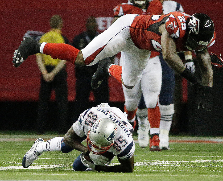 . Atlanta Falcons strong safety William Moore (25) flies over New England Patriots wide receiver Kenbrell Thompkins (85) during the second half of an NFL football game, Sunday, Sept. 29, 2013, in Atlanta. (AP Photo/David Goldman)