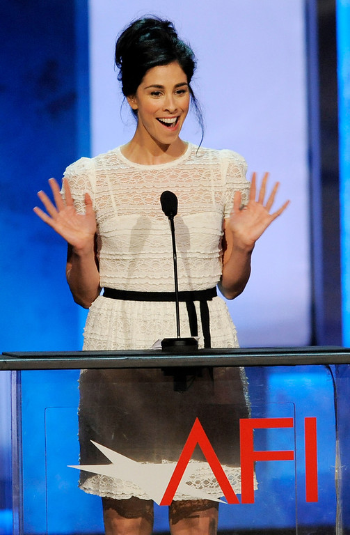 . Comedian Sarah Silverman waves to honoree Mel Brooks during the American Film Institute\'s 41st Lifetime Achievement Award Gala at the Dolby Theatre on Thursday, June 6, 2013 in Los Angeles. (Photo by Chris Pizello/Invision/AP)