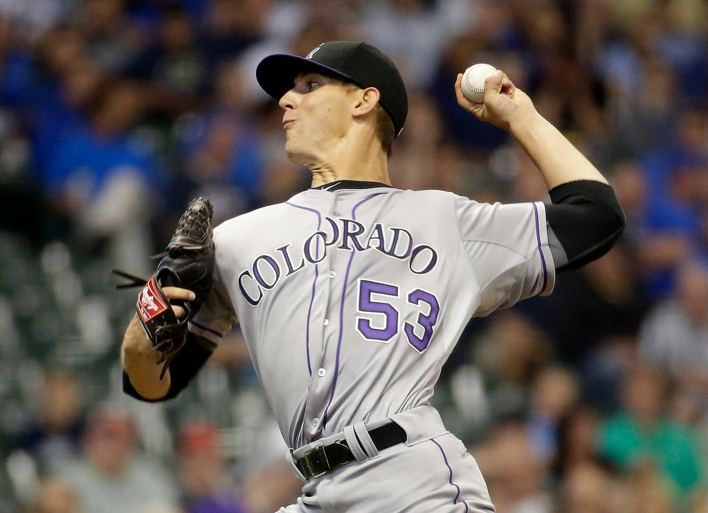 . Colorado Rockies starting pitcher Christian Friedrich throws during the first inning of a baseball game against the Milwaukee Brewers Thursday, June 26, 2014, in Milwaukee. (AP Photo/Morry Gash)