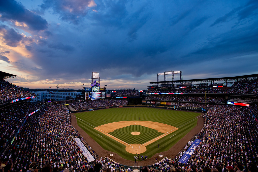 . God Bless America is performed during the middle of the seventh inning of a game between the Los Angeles Dodgers and Colorado Rockies at Coors Field on July 3, 2014 in Denver, Colorado. The Dodgers defeated the Rockies 3-2. (Photo by Justin Edmonds/Getty Images)