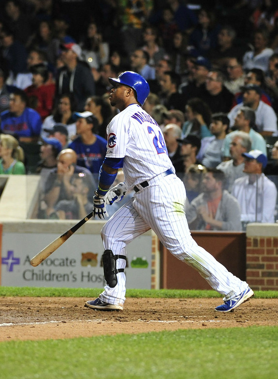 . CHICAGO, IL - JULY 30:  Luis Valbuena #24 of the Chicago Cubs hits a two-run home run against the Colorado Rockies during the eighth inning on July 30, 2014 at Wrigley Field in Chicago, Illinois. (Photo by David Banks/Getty Images)