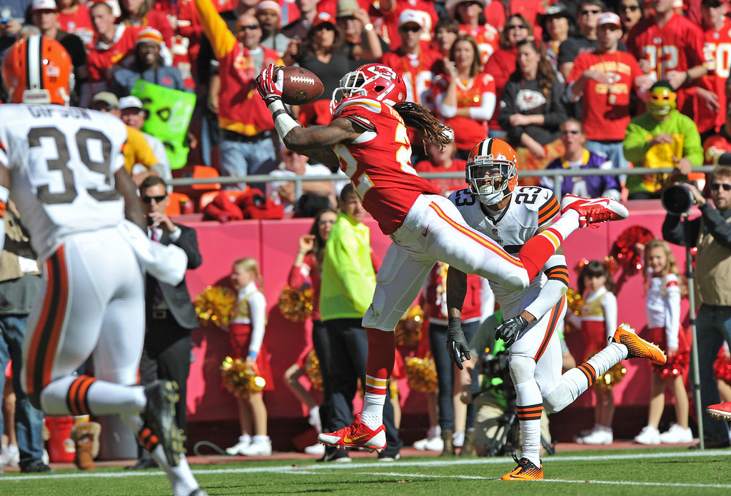 . Wide receiver Dexter McCluster #22 of the Kansas City Chiefs catches a 28-yard touchdown pass against defensive back Joe Haden #23 of the Cleveland Browns during the first half on October 27, 2013 at Arrowhead Stadium in Kansas City, Missouri. (Photo by Peter Aiken/Getty Images)